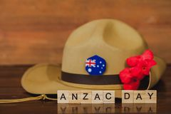 Anzac army slouch hat with Australian Flag. On vintage wood background Royalty Free Stock Photos
