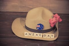 Anzac army slouch hat with Australian Flag. On vintage wood background Stock Photo