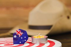 Anzac army slouch hat with Australian Flag. On vintage wood background Stock Image