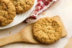 Anzac biscuit on wooden lifter. Royalty Free Stock Images