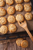 Anzac biscuits close up on a baking sheet. vertical view from ab Royalty Free Stock Photography