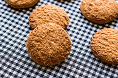 Anzac Biscuits on tablecloth. Traditional Cookies royalty free stock images