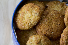 Anzac Biscuits in a Tin. Close Up of Anzac Biscuits in a Tin on a Table Stock Photo