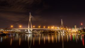 ANZAC Bridge night time long exposure. Relfection of city lights royalty free stock image