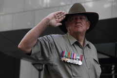 Anzac day commemorations. BRISBANE, AUSTRALIA - APRIL 25 : Veteran salutes during march as part of  Anzac day commemorations  April 25, 2013 in Brisbane Stock Images