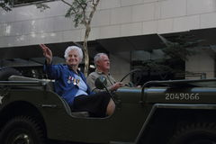 Anzac day commemorations. BRISBANE, AUSTRALIA - APRIL 25 : Veteran waves to crowd from jeep  during Anzac day commemorations  April 25, 2013 in Brisbane Stock Photos