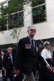 Anzac day commemorations. BRISBANE, AUSTRALIA - APRIL 25 : Veterans march along the route during Anzac day commemorations  April 25, 2013 in Brisbane, Australia Stock Image
