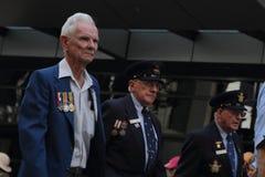 Anzac day commemorations. BRISBANE, AUSTRALIA - APRIL 25 : Veterans march along the route during Anzac day commemorations  April 25, 2013 in Brisbane, Australia Stock Photo