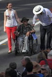 Anzac day commemorations. BRISBANE, AUSTRALIA - APRIL 25 : 104 yr old veteran Ken Blake pushed in wheelchair during along march route during Anzac day Stock Photos