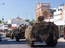 Anzac Day Procession. Anzac Day Parade with tanks and armoured vehicles driving down street with many people looking on in appreciation Royalty Free Stock Images