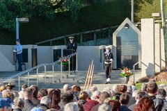 Anzac Day 2018, Tauranga NZ. A speaker from the navy at Memorial Park. At the 2018 commemoration of Anzac Day in Tauranga, New Zealand, a member of the Royal Stock Image