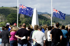 Anzac Day - War Memorial Service. MANGONUI, NEW ZEALAND - APRIL 25 2012: NZ citizens with the Australian and New Zealand flags in the background at the National Stock Image