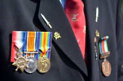 Anzac Day - War Memorial Service. Close up of war medals on New Zealander soldier during a National War Memorial Anzac Day services in New Zealand Stock Photos