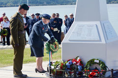 Anzac Day - War Memorial Service. MANGONUI, NEW ZEALAND - APRIL 25 2014:New Zealand Army officers placing flower wreaths on Mangonui war memorial during Anzac Royalty Free Stock Image