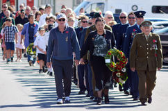 Anzac Day - War Memorial Service. MANGONUI, NEW ZEALAND - APRIL 25 2014: New Zealanders and New Zealand Army veterans and officers march at the opening of the Stock Image