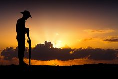 ANZAC soldiers Silhouette. Silhouette of Australian ANZAC soldiers against the sky.Artist drawn silhouette on photo background Royalty Free Stock Image