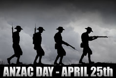 ANZAC soldiers Silhouette. Silhouette of Australian ANZAC soldiers against the sky.Artist drawn silhouette on photo background Stock Photo
