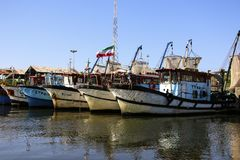 ANZALI, IRAN- SEPTEMBER 25, 2018: Fishing boats in port Anzali, port on Caspian sea, Iran.  royalty free stock photo