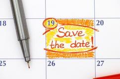 Anzeigen-Abwehr das Datum im Kalender mit Stift Stockbilder