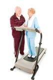 Anziani che flirtano alla ginnastica Fotografie Stock