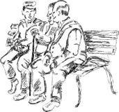 Anziani che parlano sul banco Fotografie Stock