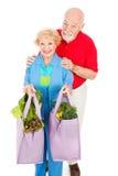 Anziani in condizioni ambientali informati Fotografia Stock Libera da Diritti