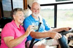 Anziani di rv con il GPS Immagini Stock