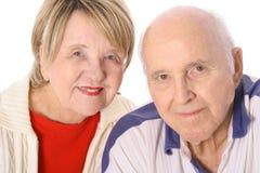 Anziani isolati insieme su bianco Immagine Stock