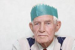 Anziano al partito fotografie stock