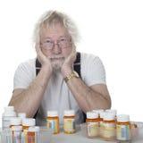 Anziano con i lotti delle prescrizioni Fotografie Stock Libere da Diritti