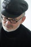 Anziano con il cappuccio e la barba Fotografie Stock Libere da Diritti