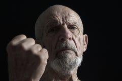Anziano con il pugno 2 fotografia stock libera da diritti