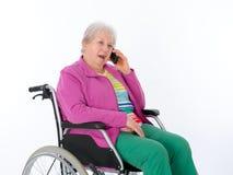 Anziano femminile in sedia a rotelle Fotografia Stock