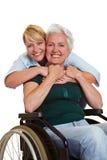 Anziano invalido d'abbraccio della donna Fotografia Stock Libera da Diritti