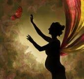 Anziehende Basisrecheneinheit der schwangeren Frau. Stockfoto