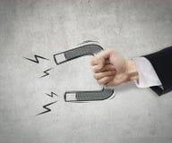 Anzuziehen Geschäftsmanngebrauchsmagnet Stockbilder