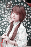 Ao lado chinês bonito da menina Imagens de Stock Royalty Free