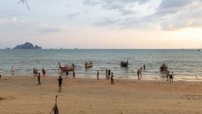 Ao Nang Beach Time Lapse. Krabi, Thailand - April 15 2018: Time lapse video of tourists and locals enjoying Ao Nang Beach in Krabi, Thailand just before sunset stock video