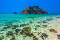 AO Nang, Krabi, Thailand. Stones in the transparent water of the Tup Island royalty free stock images