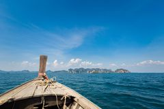 Ao Nang from the sea. Longtail boat on tropical Ao Nang beach  in Thailand. Landscape taken from the sea with blue sky and white sand Royalty Free Stock Images