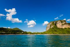 Ao Nang from the sea. Longtail boat on tropical Ao Nang beach  in Thailand. Landscape taken from the sea with blue sky and white sand Royalty Free Stock Photography