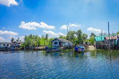 AO NANG, THAILAND - FEBRUARY 19, 2018: Outdoor view of long tail fishing boats in the border of the river close to some. Buildings at fish farms in Krabi Royalty Free Stock Photos