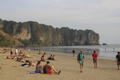 AO NANG, THAILAND, FEBRUARY 10, 2015 : Tourists enjoying the beautiful and wide Railay West beach surrounded by awesome cliffs in Stock Photography