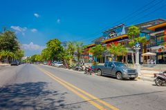 AO NANG, THAILAND - MARCH 05, 2018: Outdoor view of some cars and motorcycles parked in the street close to local shops. At Ao Nang beach front market, in stock image