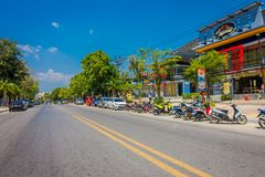 AO NANG, THAILAND - MARCH 05, 2018: Outdoor view of some cars and motorcycles parked in the street close to local shops. At Ao Nang beach front market, in stock photography