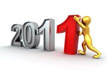 Año Nuevo. Hombres con los números 2011 Imagen de archivo libre de regalías