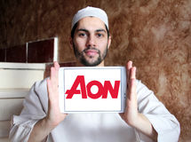 AON insurance logo. Logo of AON insurance company on samsung tablet holded by arab muslim man. Aon plc is a global professional services firm that provides risk Stock Photos