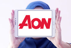 AON insurance logo. Logo of AON insurance company on samsung tablet holded by arab muslim woman. Aon plc is a global professional services firm that provides Royalty Free Stock Photos