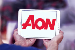 AON insurance logo. Logo of AON insurance company on samsung tablet. Aon plc is a global professional services firm that provides risk, retirement and health Stock Photography
