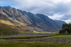 Aonach Eagach ridge above Loch Achtriochtan in Glencoe, Scotland Stock Photos